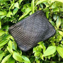Le sac / pochette en cuir...